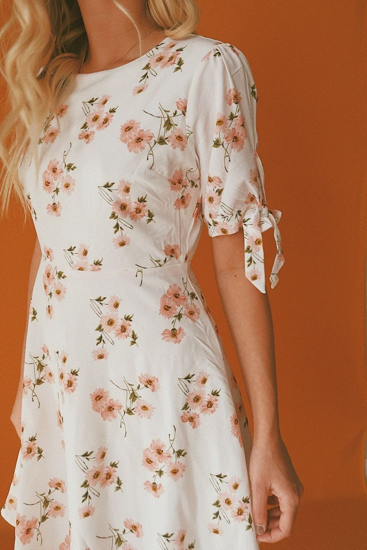 Photo of Floral dress with tie sleeves