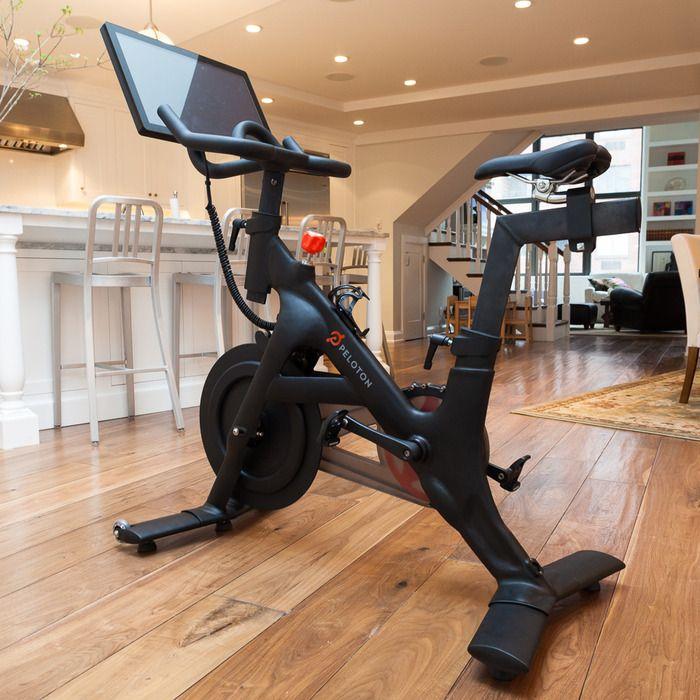 The Peloton Bike Bring Home The Studio Cycling Experience Indoor Spinning Peloton Bike Biking Workout
