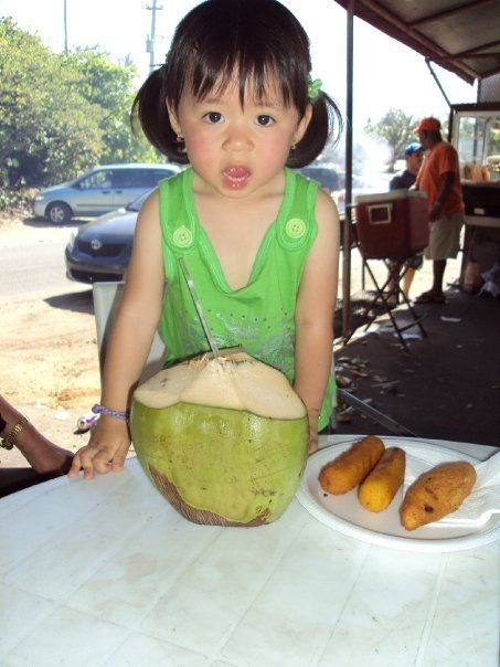 Jeanna at age 2 enjoying her first Puerto Rican Coconut and soruchitos de maíz!
