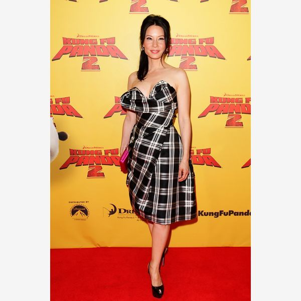 """Actress Lucy Liu wows in a black-and-white plaid dress at the Australian premiere of """"Kung Fu Panda 2"""" in Sydney in June 2011. Once the province of casual outfits, plaid can be found in short and long formal wear, which is often the choice of the super trendy."""