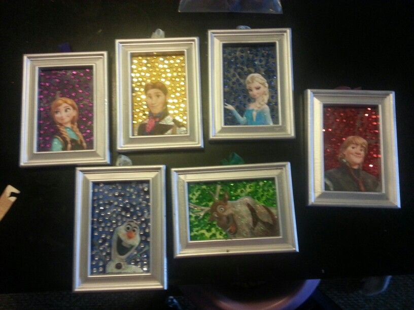 Frozen pictures. Back is blown crayon with sequences for sparkle and the frames are spray painted dollar store frames characters printed of internet