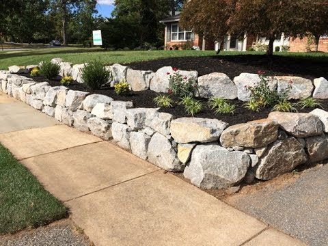 Nature S Call Granite Boulder Retaining Wall Boulder Retaining Wall Rock Wall Landscape Driveway Entrance Landscaping