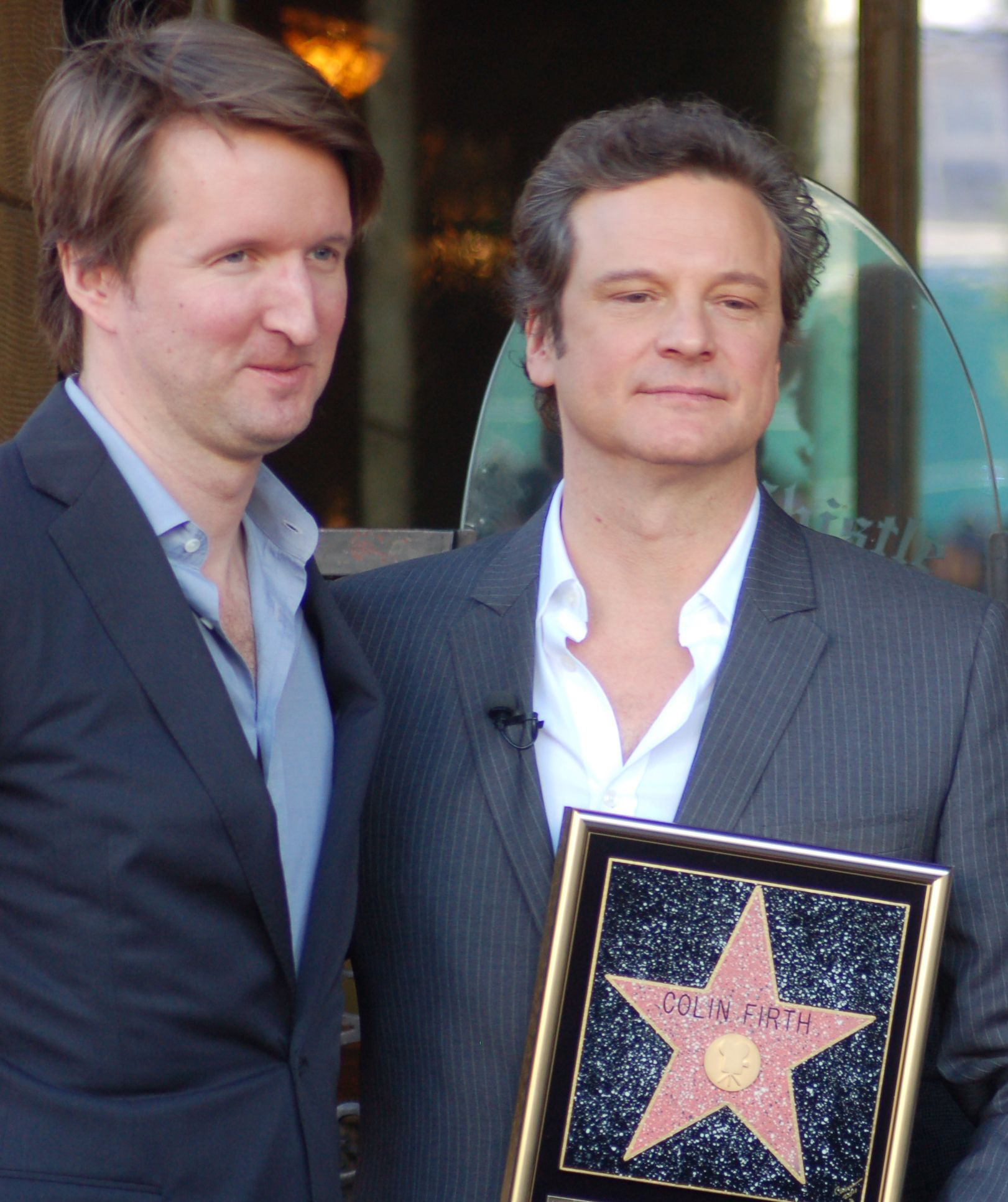 Tom Hooper and Colin Firth at a ceremony for Firth to receive a star on the Hollywood Walk of Fame.
