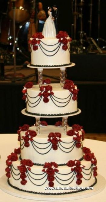 Tall White Wedding Cake Done In Separated Tiers With Black And Wine