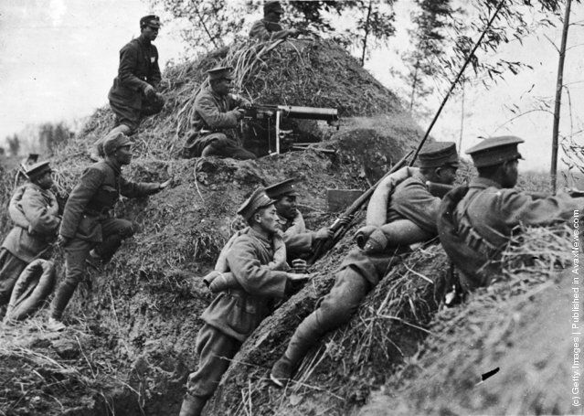 1938: Chinese soldiers use a dirt embankment as protection from fire during a battle in the Sino-Japanese War, Shanghai, China