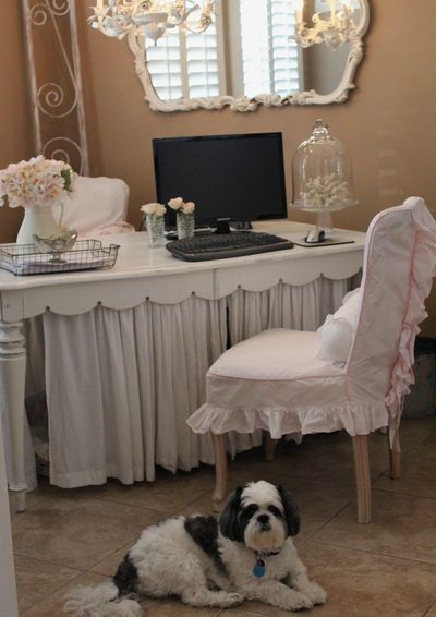 Love the table detail.  Also would put two lamps at each end, and the initial K on the wall.  Mirror on wall with girly curtains.
