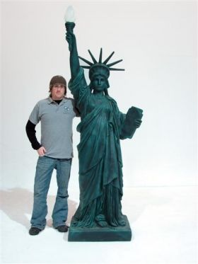what item does the statue of liberty hold high