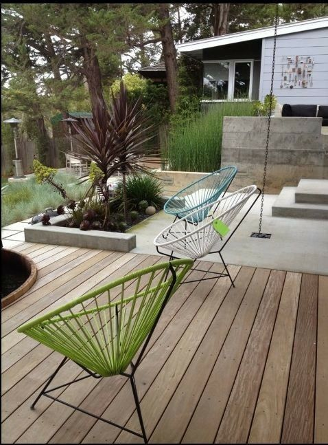 wood deck next to concrete patio