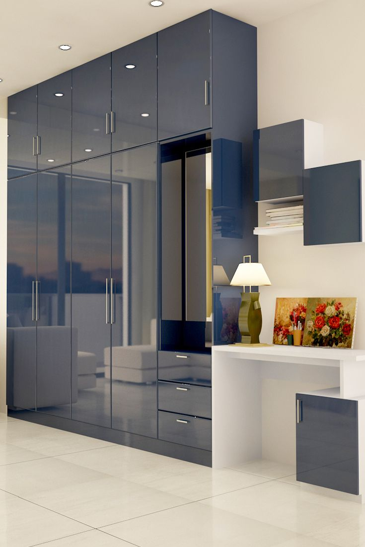 Paprika multifunctional hinged wardrobe glossy finish and a subtle colour palette lend this Wardrobe in master bedroom