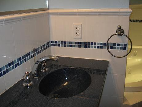 residential bathroom using prism colorways bluesfest glass tile blend as a border design
