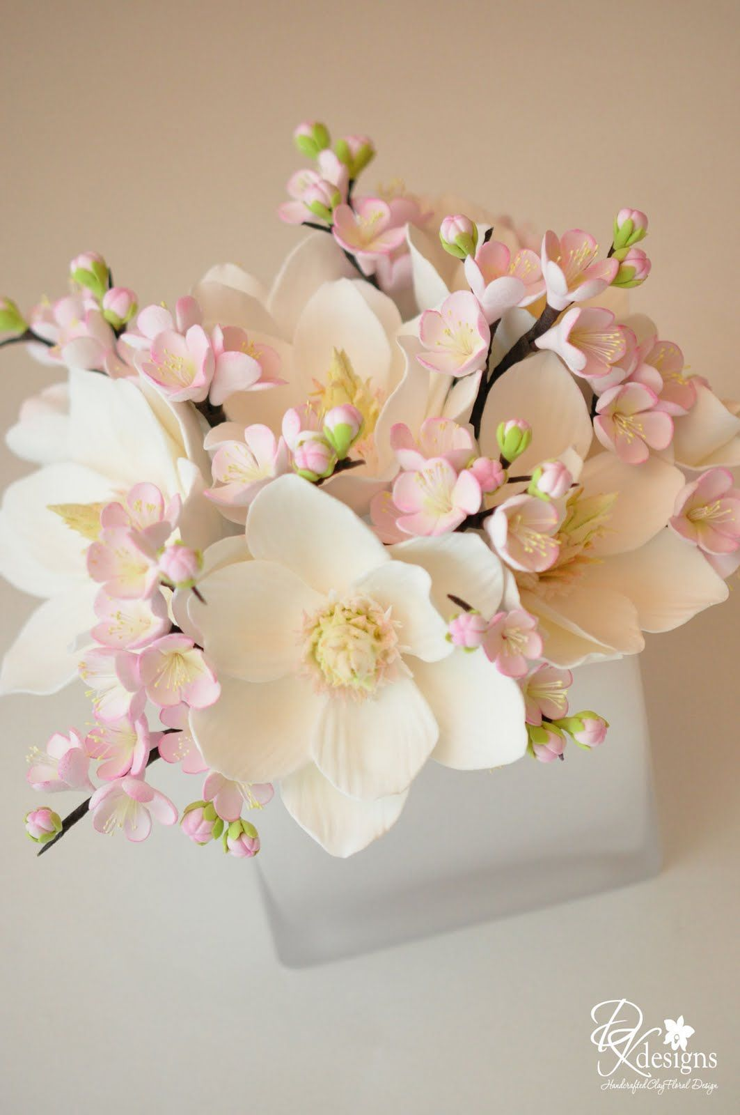 delicate blush and white floral arrangement (magnolias and plum