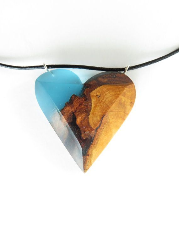 Heart shaped necklace made by wood and blue resin. Handmade jewlery by WoodAllGood #WoodAllGood