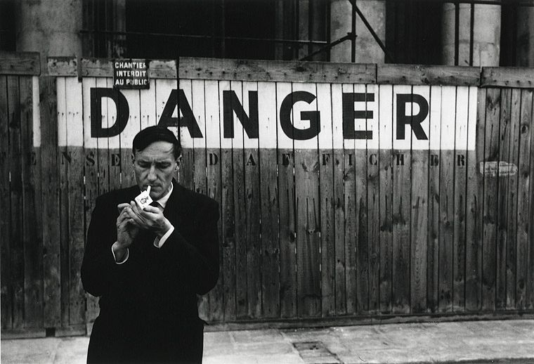 Portrait of William S. Burroughs in front of the Théâtre Odeon, Paris. © Brion Gysin, Oct. 1959, 'Danger Series'.