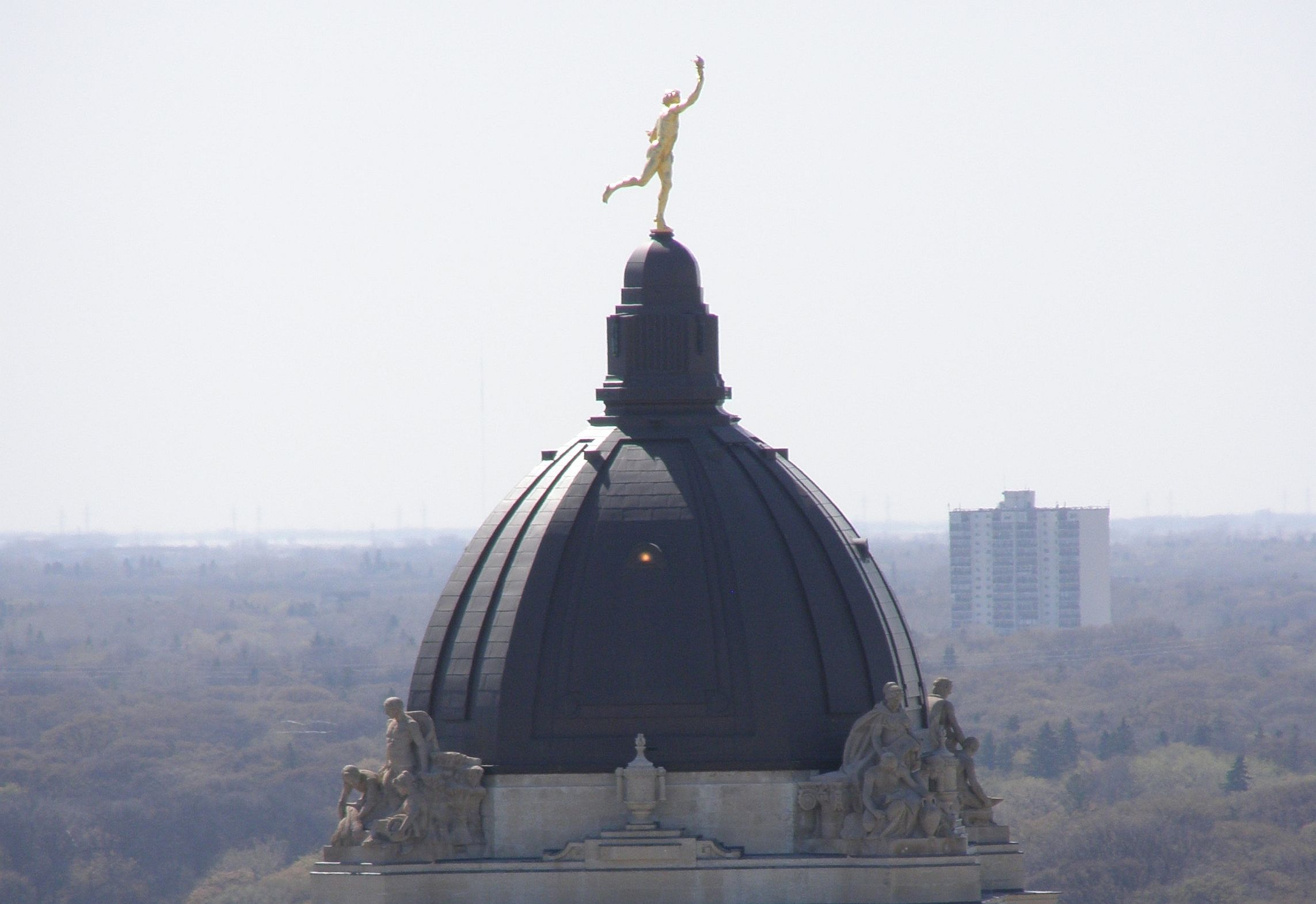 Golden Boy - at top of Manitoba Legislature Bldg. circa 04-2010. Photo taken in Winnipeg MB.