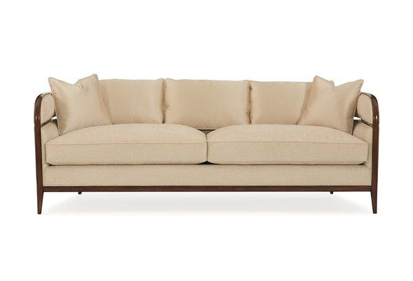 This Elegant Low Profile Sofa Has A Sleek Exposed Wood Frame With