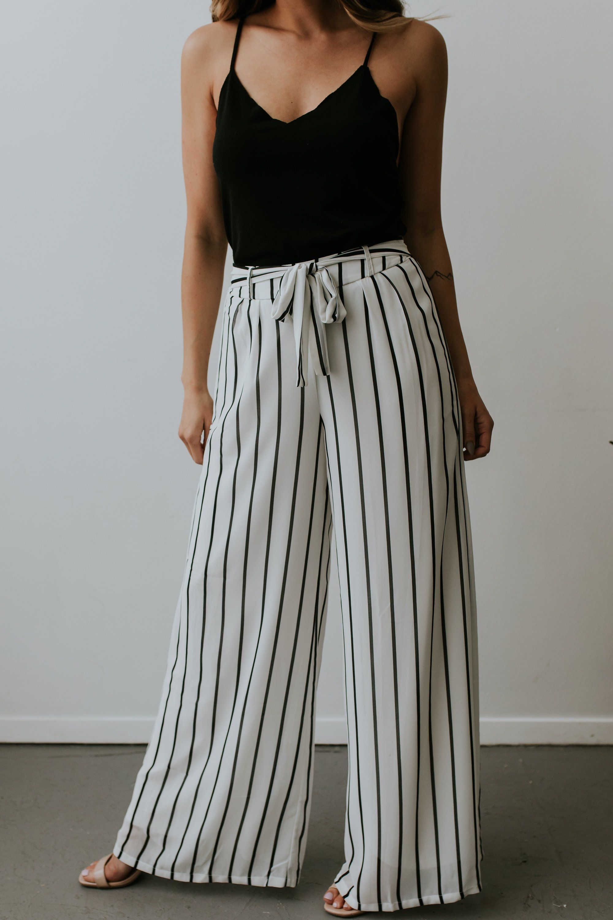 1c41232b2 Description: Solid tulip pants with self tie ribbon at waist Fabric ...