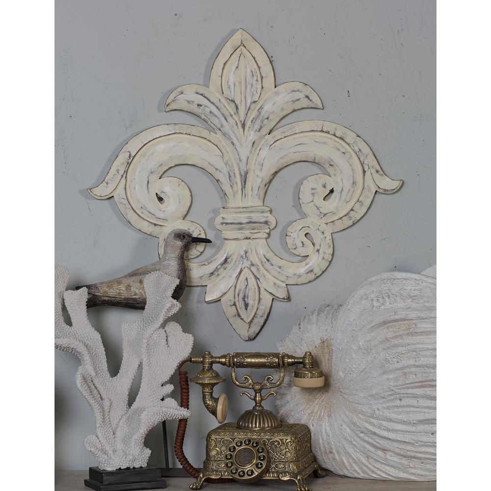 Litton lane frenchinspired whitewashed fleurdelis wooden wall art