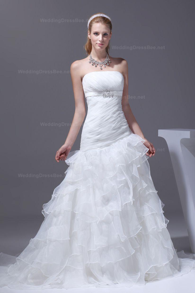 Dropped waist wedding dress  Strapless organza wedding dress with an asymmetrical dropped waist