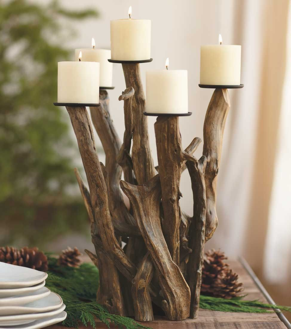 Dark Driftwood Candelabra: Naturally sculpted and worn smooth by wind and seawater, entwined pieces of driftwood form a dramatic candelabra centerpiece that holds seven pillar candles. No two alike.  ;p