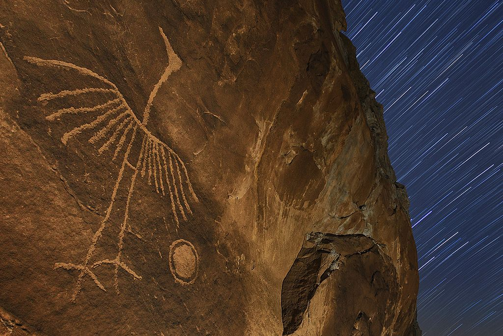 The Phoenix | Rarely photographed petroglyph captured under the stars. This is one of the most interesting glyphs I've never seen...so simple yet so powerful. It's quite large, about to two feet in total height.