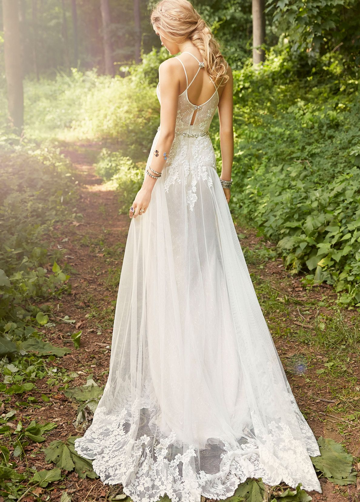 Ivory cashmere aline bridal gown with placed lace throughout