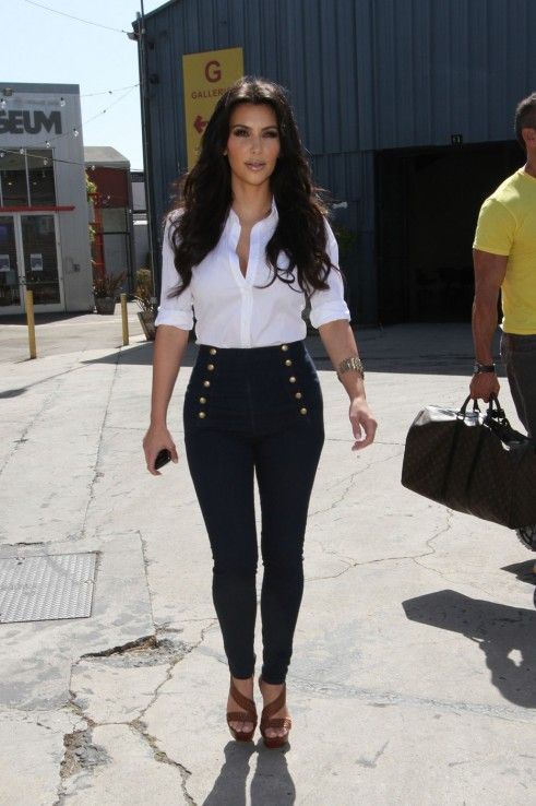 Kim Kardashian Wearing High-Waisted Jeans with Gold Buttons.