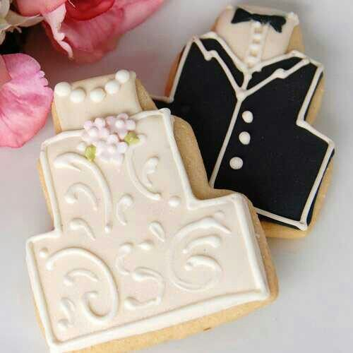 Wedding dress, and tuxedo cake shaped cookies.