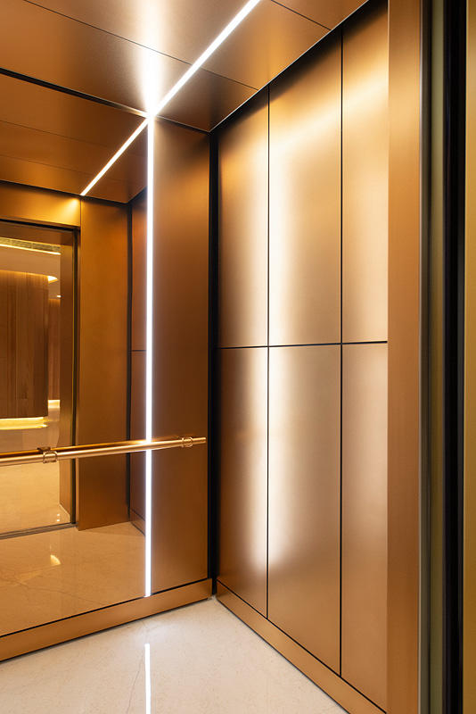 Levele 105 Elevator Interior With Customized Panel Layout Minimal Panels In Fused Bronze With Seastone Elevator Interior Elevator Design Lobby Interior Design