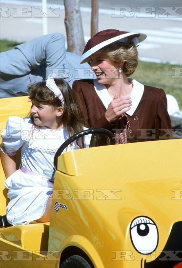 Princess Diana rides in a childs mini training car with 9 year old Camille Montgomery at the Puckapunyal Army Centre Road Safety School, Victoria
