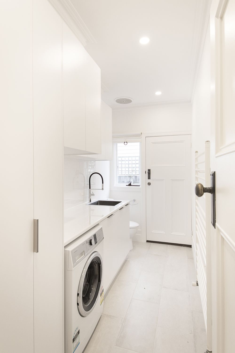 Brunswick Bathroom Renovation: A Traditional White And Grey Laundry Renovation In