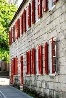 Magna Carta Court Bay Street In Nassau Bahamas With Beautiful Exposed Brick And Bright Red Shutters Bahamas Vacation Red Shutters Nassau Bahamas