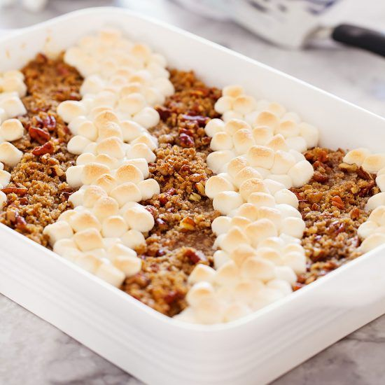 This crowd-pleasing sweet potato casserole has both a pecan topping and a marshmallow topping for the best of both worlds! #sweetpotatocasserolewithmarshmallows