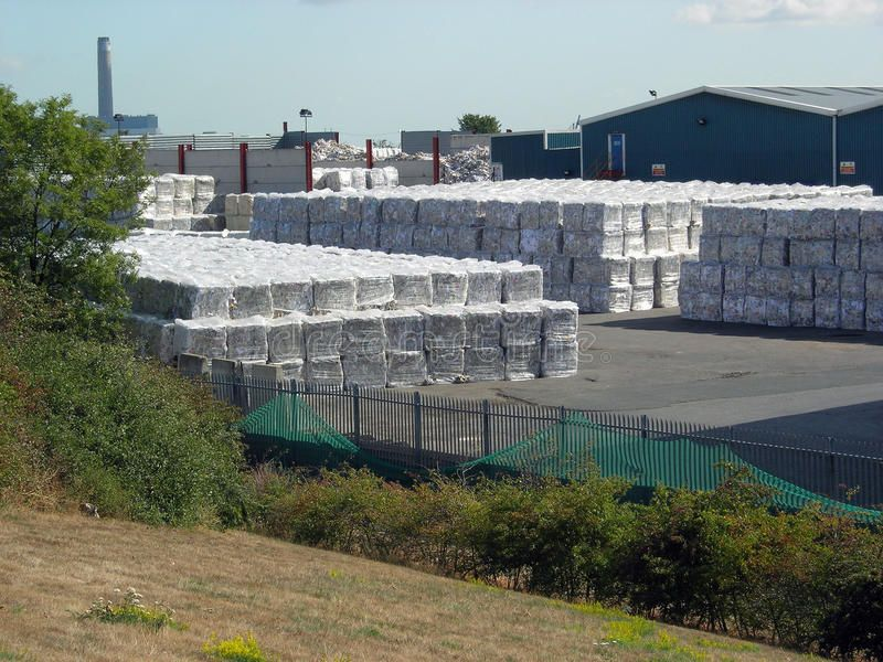 Waste recycling plant Bales of recycled waste material stacked and awaiting tra