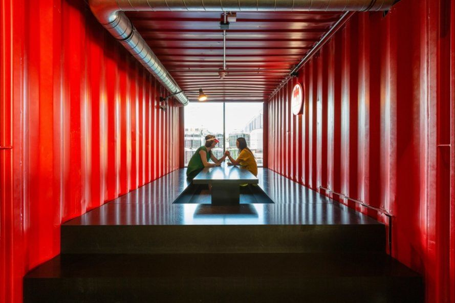 Harbor town in Germany unveils urban-chic hostel made out of repurposed shipping containers