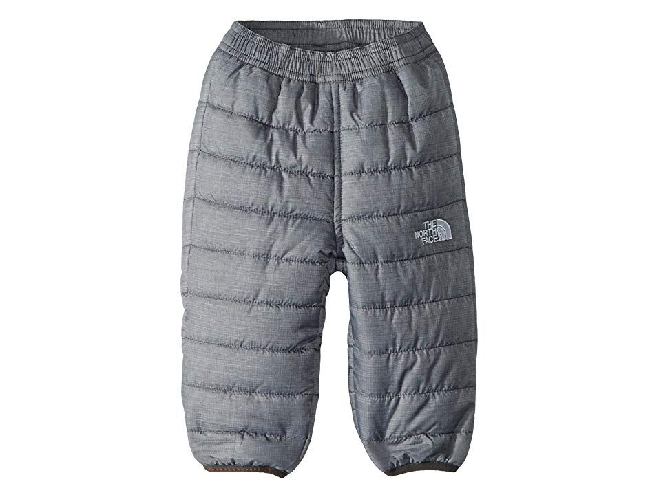 The North Face Kids Reversible Perrito Pants (Infant) (TNF Medium Grey Heather/Graphite Grey) Kid's Outerwear. Keep your little adventurer warm and dry on their first snow day this season. Compressible 160 g Heatseeker synthetic insulation delivers lightweight  reliable warmth without the bulk. Encased elastic waistband. Elastic binding on cuffs. Reversible print design options. Branding on left leg. 100% polyester. Machine wa