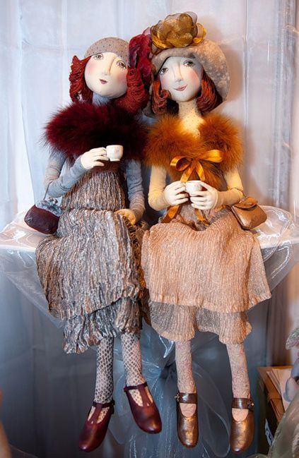 Does anyone know who made these beautiful dolls or what website the image came from?
