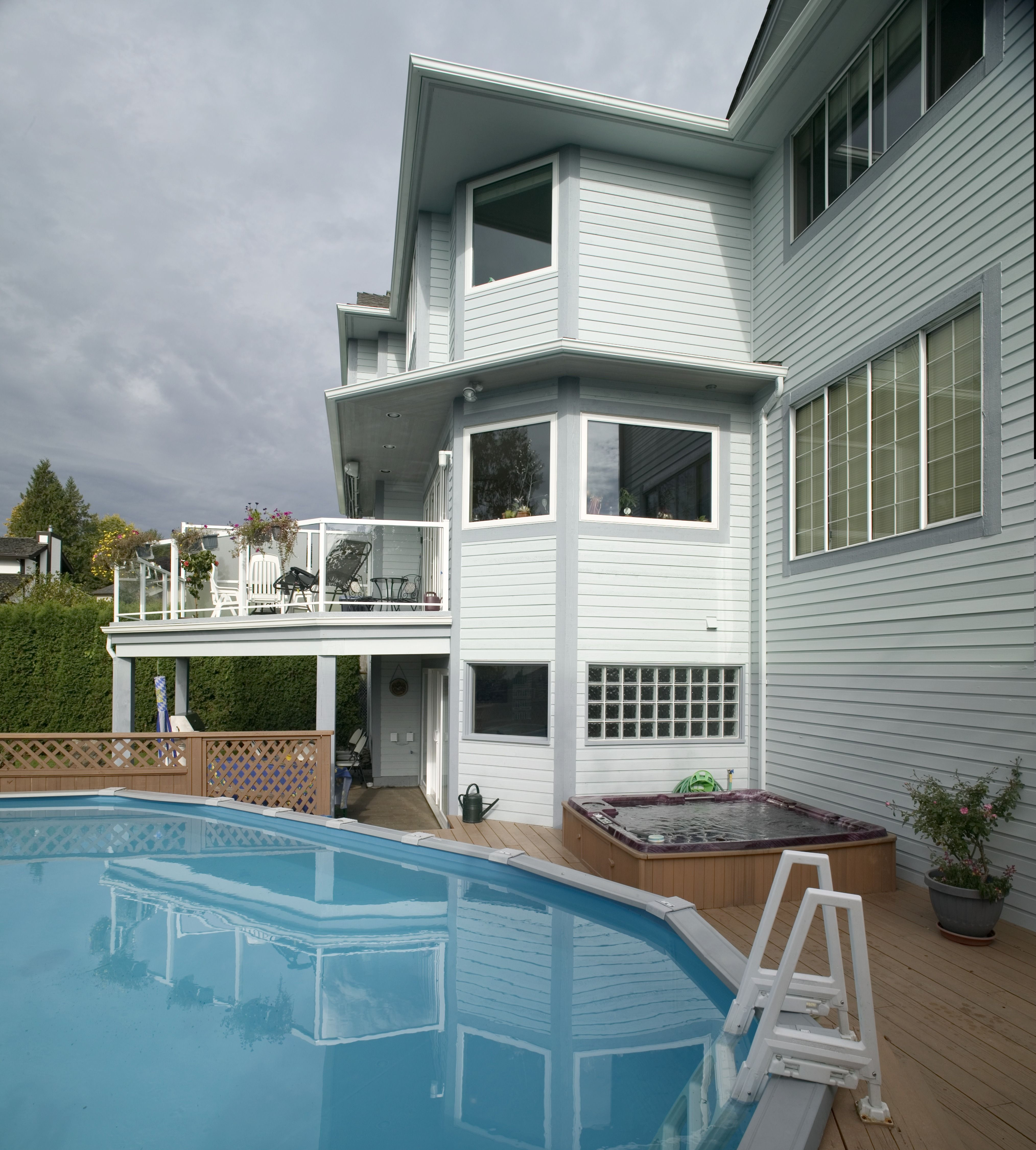 huge deck with a wide pool and a tub in front i believe our