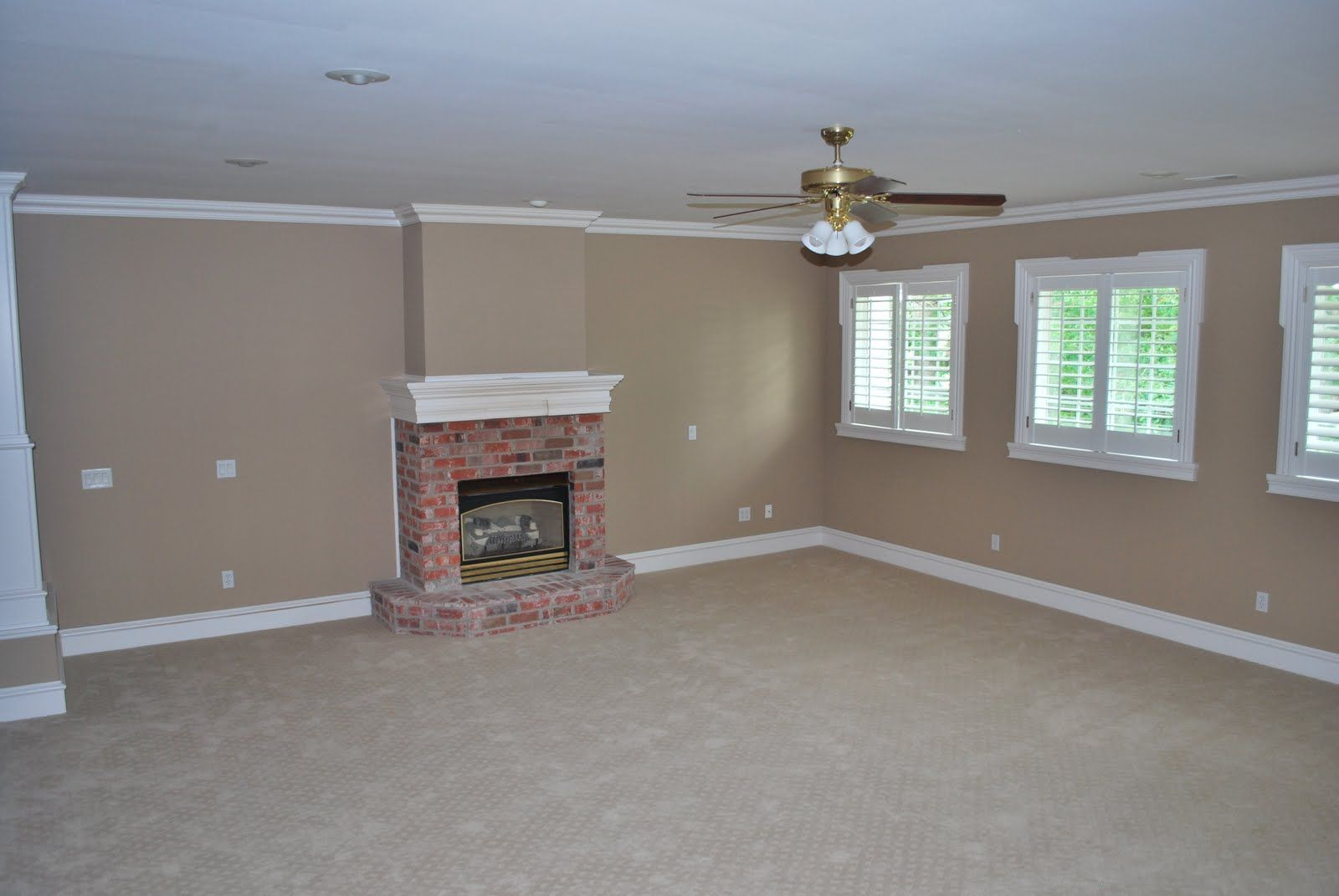 wall color to complement red brick fireplace | she's a brick