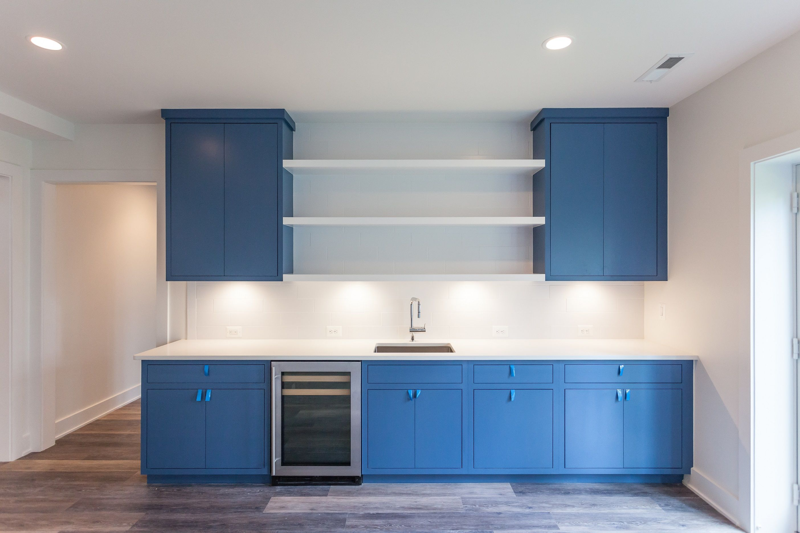 Royal Navy Blue Inset Slab Cabinets With White Subway Tile And