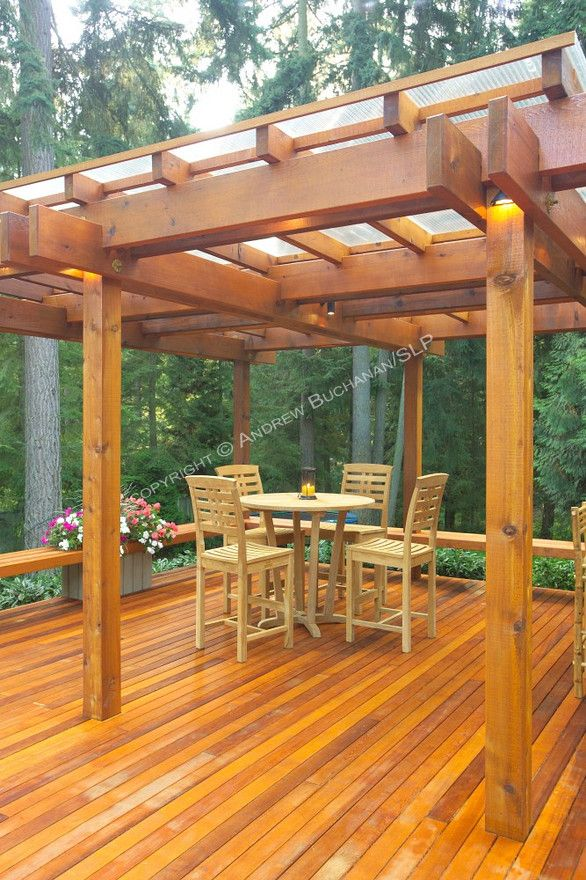 A 1700 Square Foot 2 Level Deck Outdoor Kitchen And Firepit Complete The Outside Of This Ranch Style Home Tucked Among Towering Fir Pergola Rustic Pergola Pergola Patio