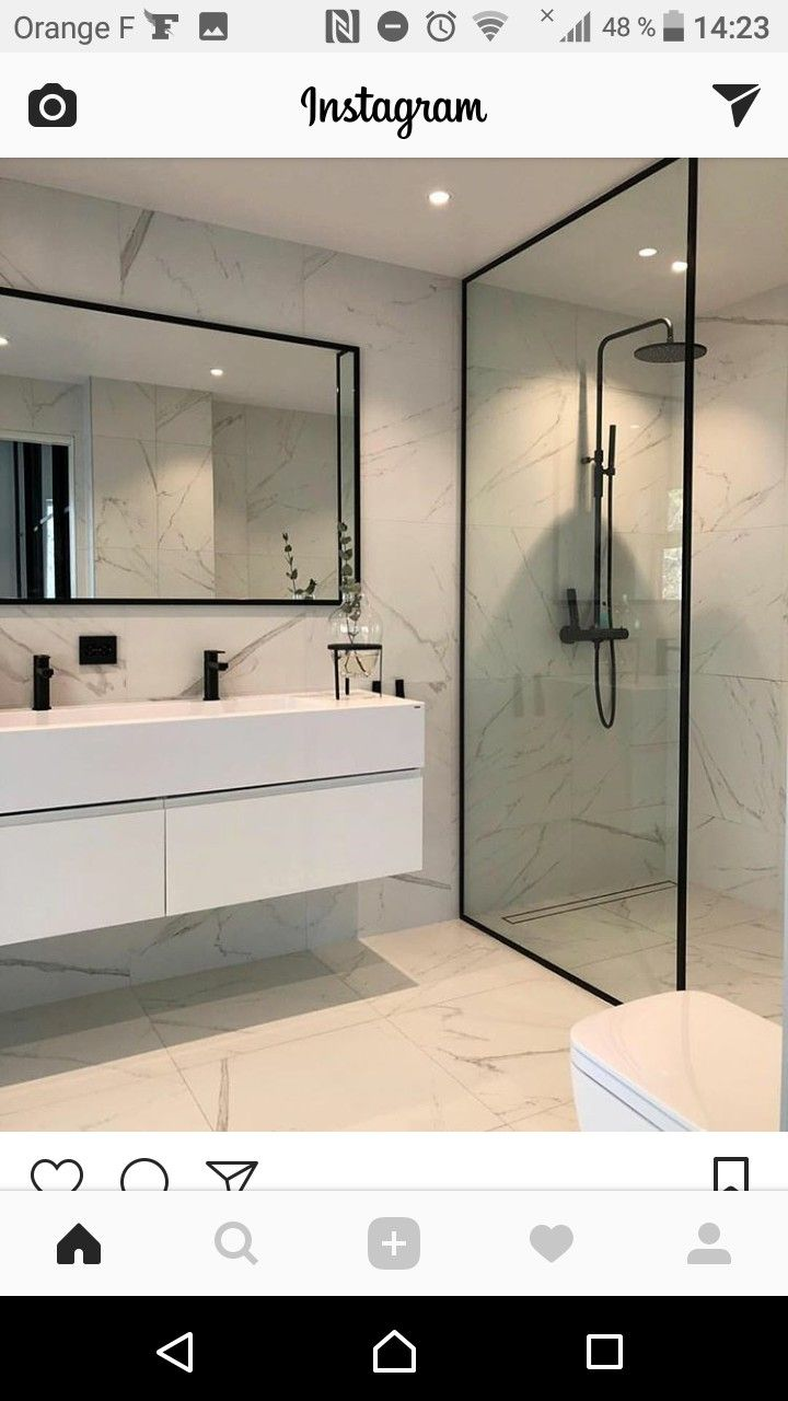 Salle De Bain Borgne a black and white theme bathroom with a light grey granite
