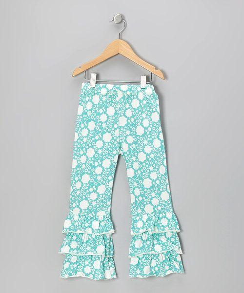 Crafted with organic cotton, an elastic waistband and a trio of ruffles on each leg, these playful pants epitomize comfort and charm. 100% organic cottonMachine washImported
