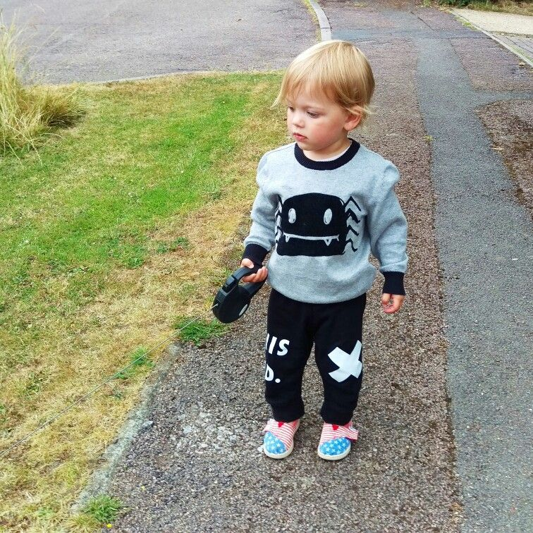 Grey and black spider jumper from H&M, black 'This Kid' leggings from Three Bears Threads and slip on shoes from @toms