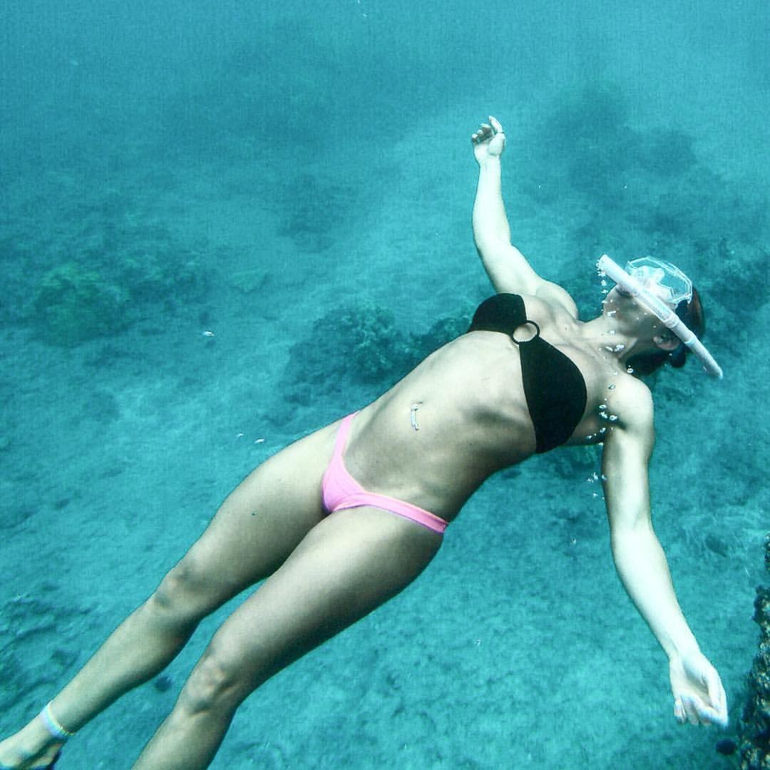 Woman swimming underwater with pink bikini in swimming pool, stock photo