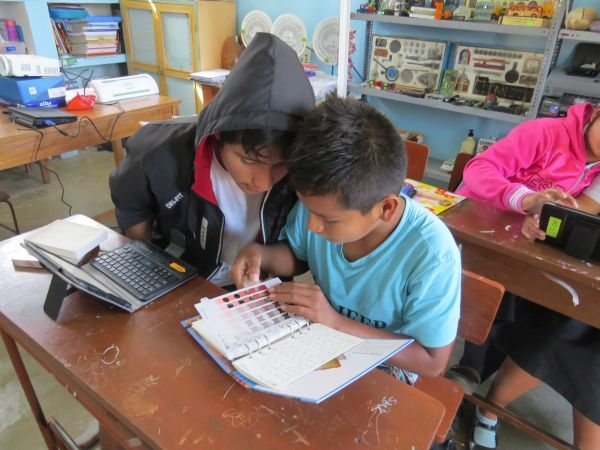 students in nivin peru learning to use the munsell color book to record data - Munsell Color Book