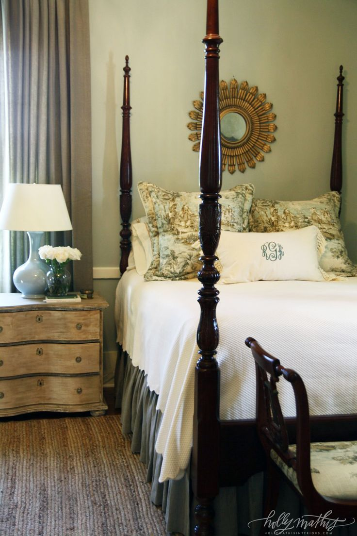Louisiana Farmhouse by Holly Mathis Interiors. Love the look of the distressed-wood nightstand against the polished bed.