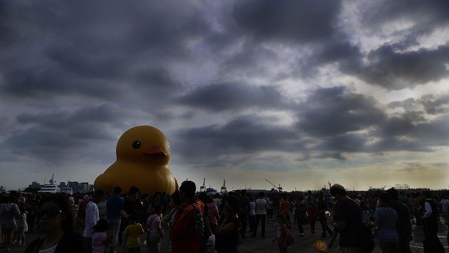 500px / Yellow Rubber Duck During Typhoon Day by Miles Lin