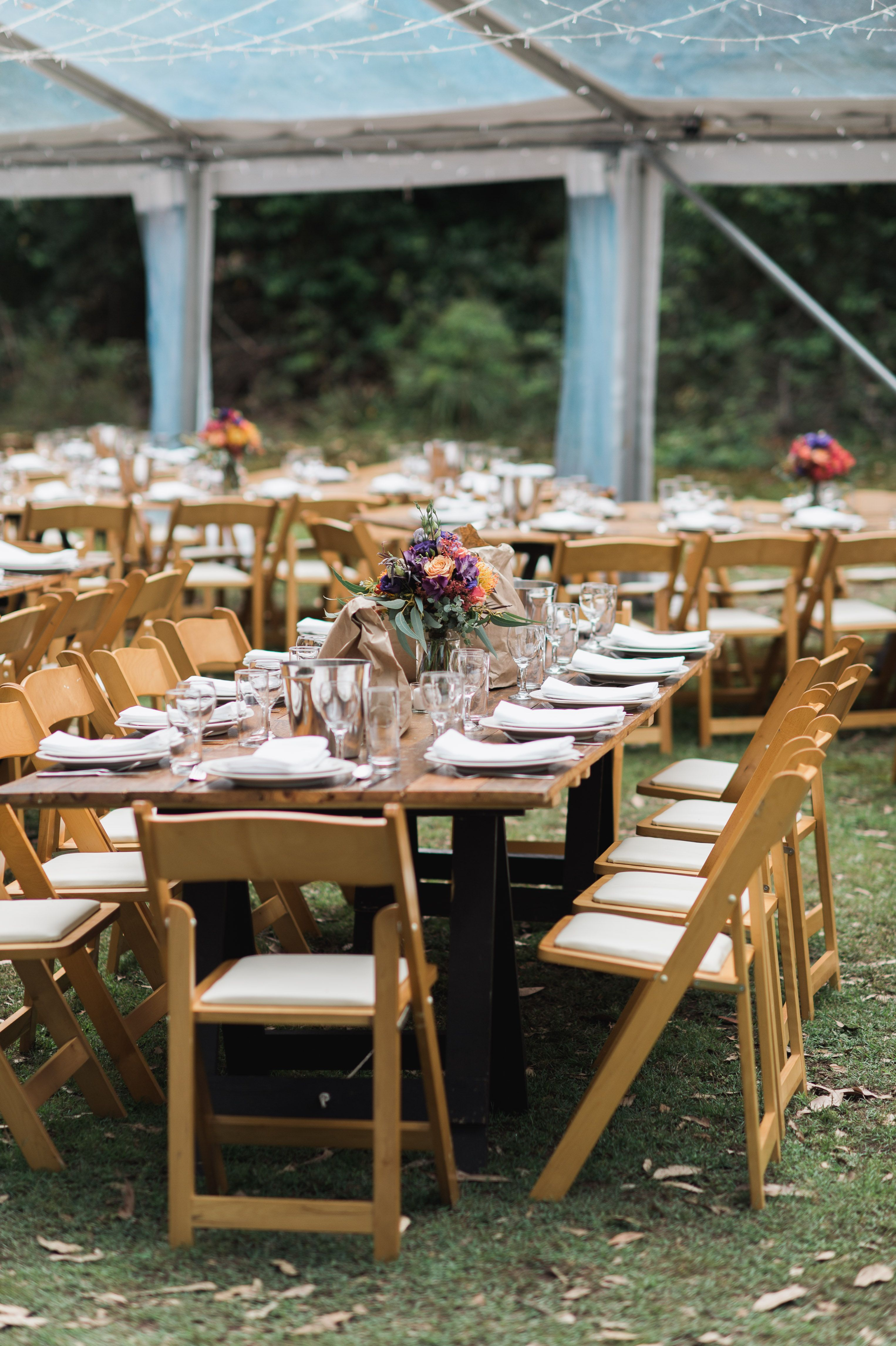 Wooden padded folding chairs clear marquee vintage timber trestle tables