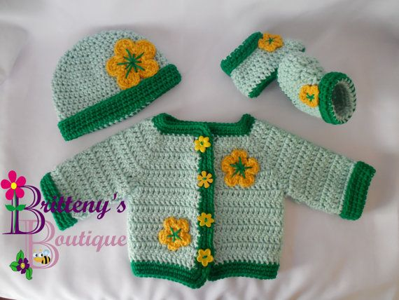 I love how springy this set turned out!  I started this set with the green yarns, and when it was all done, I happened on these yellow flower buttons in my collection.  Once I had those on the sweater, I just knew it had to have flower appliques to pull it all together!!  This would make a great shower gift for a spring arrival!  This set was made using my Two Tone Sweater Set pattern, so you know it was made with extra love! This pattern can be found for free on m blog.