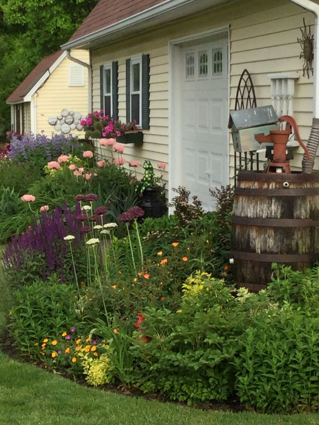 Packed with Beauty, Part 1 is part of Beautiful garden Inspiration - Learn how this gardener in Michigan deals with creating an appealing landscape right next to a large factory space  Choosing plants wisely, as well as packing them closely together leads to great results!
